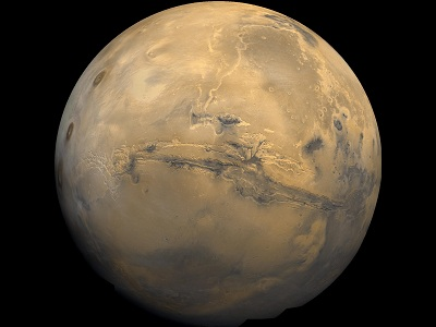 "The uniquely red <a href=""/mars/interior/Martian_global_geology.html&edu=high"">global surface</a> of Mars is marked by many interesting features - some like those on the <a href=""/earth/earth.html&edu=high"">Earth</a> and others strangely different. The reddish color is caused by rust (iron oxide) in the <a href=""/mars/exploring/martian_soils.html&edu=high"">soil</a>.  Some of these features are; <a href=""/mars/interior/mars_volcanoes.html&edu=high"">volcanoes</a>, canyon systems, <a href=""/mars/interior/Martian_running_water.html&edu=high"">river beds</a>, <a href=""/mars/interior/Mars_cratered_terrain.html&edu=high"">cratered terrain</a>, and <a href=""/mars/interior/Martian_dunefields.html&edu=high"">dune fields</a>.  This image shows a global mosaic of 102 Viking 1 Orbiter images of Mars taken in February, 1980.<p><small><em>Image courtesy of NASA.</em></small></p>"