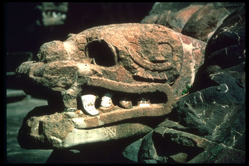 Side view of an ancient Aztec carving depicting Quetzalcoatl, the Plumed