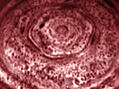 "Astronomers have discovered a bizarre, <a href=""/saturn/atmosphere/polar_hexagon.html"">hexagon-shaped feature</a> in the <a href=""/saturn/atmosphere/S_clouds_overview.html"">clouds of Saturn</a> near the planet's <a href=""/saturn/saturn_polar_regions.html"">North Pole</a>. The feature was first seen in images returned by the <a href=""/space_missions/voyager.html"">Voyager spacecraft</a> in the 1980s. The <a href=""/missions/cassini.html"">Cassini spacecraft</a> took this infrared image of the hexagon in 2006.  Scientists think the feature is some sort of wave in <a href=""/saturn/lower_atmosphere.html"">Saturn's atmosphere</a> about 75 kilometers beneath the planet's visible cloud tops.<p><small><em>Image courtesy NASA/JPL/University of Arizona</em></small></p>"